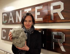 Rebecca Priestley holding pumice freshly erupted from the Havre volcano, found on a voyage that she participated on to the Kermadec islands.