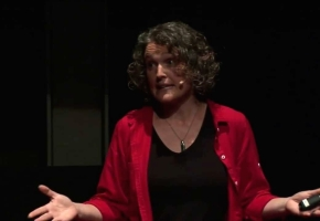 Rhian Salmon giving a TEDx talk on climate change.