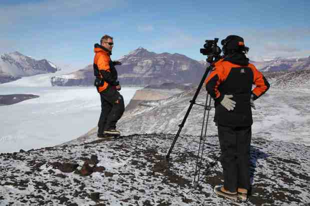 Cliff talks about the geology of the Transantarctic Mountains, from a great viewing spot on Friis Hills. Photo Rebecca Priestley.