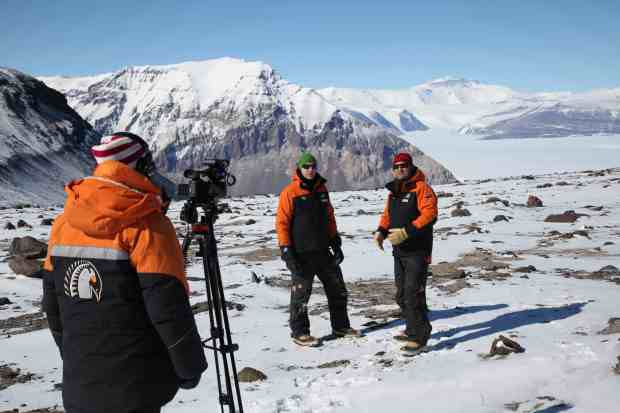 Cliff interviews Nick Golledge, from the Antarctic Research Centre, while Rebecca hides inside her extreme cold weather gear.