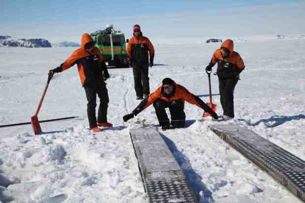 On the way to Cape Evans, cracks in the sea ice meant we needed to lay a bridge before driving over. Photo Rebecca Priestley