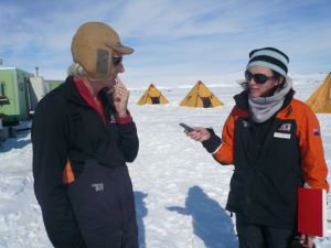 Sciecne historia Rebecca Pristley interviews Andrew McMinn wearing an aviation hat in Antarctica